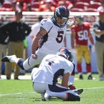 Denver Broncos kicker Matt Prater (5) kicks out of the hold by punter Britton Colquitt (4) against the San Francisco 49ers during the second quarter at Levi's Stadium.