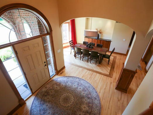 3 minute tour west des moines home features colorado style for 2 story spiral staircase