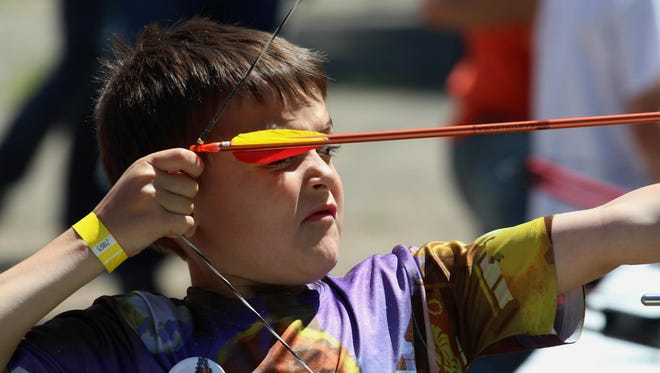 Ryland Struzynski, 6, of Nekoosa, gets ready to let fly with an arrow in the archery area at the Kiwanis sponsored Youth Outdoors Day near Wisconsin Rapids.