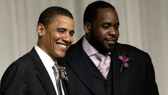 Then-U.S. Sen. Barack Obama, D-Ill., left, is greeted by then-Detroit Mayor Kwame Kilpatrick  in Detroit, Sunday, May 1, 2005.
