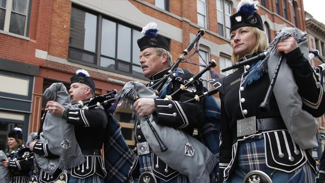 Members of Broome County Celtic Pipes & Drums march down Court Street during a previous Parade Day in downtown Binghamton.