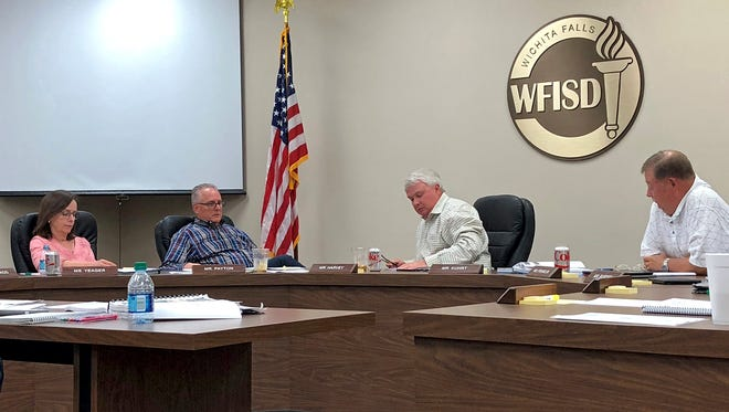 Members of the Wichita Falls ISD Board of Trustees discuss long term planning for the district's facilities Tuesday night at a special session.