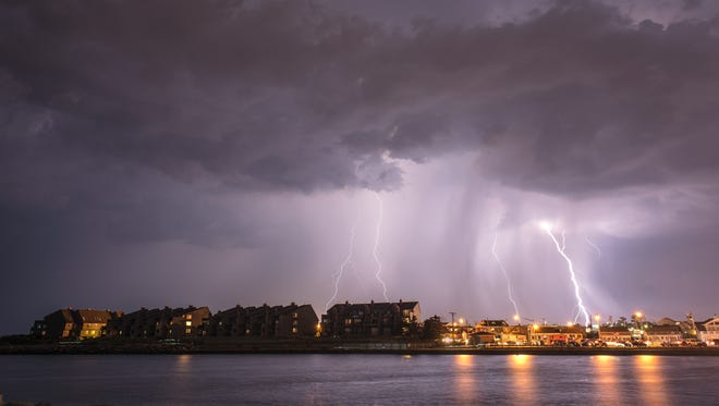 Lightning strikes during thunderstorm over Point Pleasant Beach, as seen across the Manasquan Inlet, in this 2012 file photo.