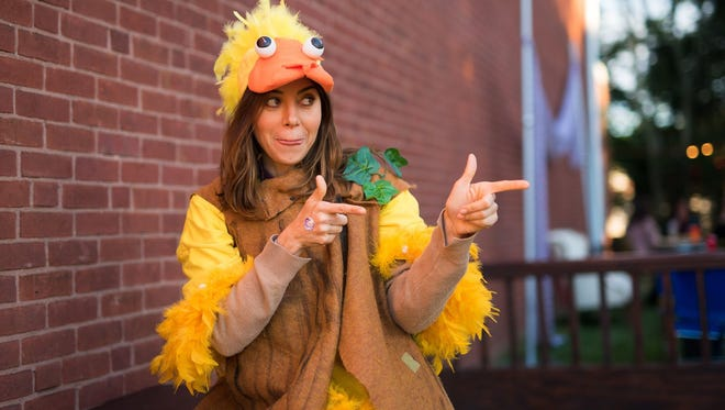 Actress and Wilmington native Aubrey Plaza hams it up at the Wilmington Drama League's homecoming block party fundraiser in 2018.
