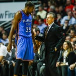 Oklahoma City Thunder coach Billy Donovan (R) talks with Oklahoma City Thunder forward Kevin Durant (L) in a recent game.