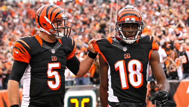 Bengals quarterback AJ McCarron (5) celebrates with wide receiver A.J. Green (18) after connecting for a long touchdown in the second quarter of Sunday's loss to the Steelers.