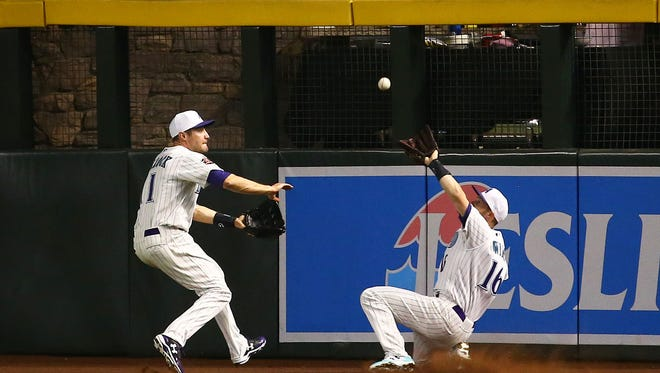 Arizona Diamondbacks Chris Owings (right) make the catch and collides with A.J. Pollock on a fly ball from San Francisco Giants Joe Panik in the 3rd inning on Apr. 19, 2018 at Chase Field in Phoenix, Ariz. Chris Owings left the game.