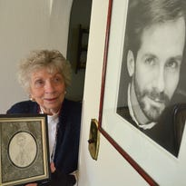 Arlene Bubb is shown with a caricature and photo of her son Brian, who died from AIDS.