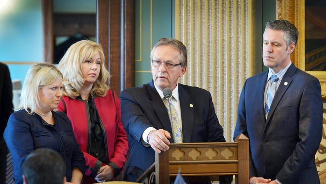 Sen. Mike Nofs, R-Battle Creek, honors the victims of the recent fatal shootings in Kalamazoo County on Tuesday, Feb. 23, as Southwest Michigan colleagues, from left, Sens. Margaret O'Brien, Tonya Schuitmaker and John Proos look on.