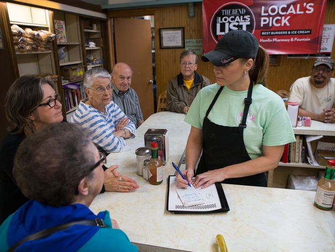 Waitress Mary Lloyd takes customers' lunch orders at
