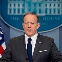 Sean Spicer has something stuck in his teeth