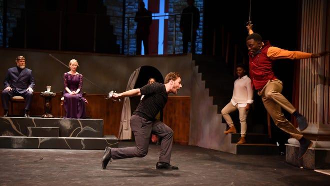 "Sam Ashdown as Hamlet and Audrey Tchoukoua as Laertes in Nashville Shakspeare Festival's ""Hamlet."""