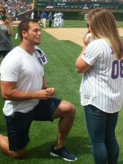 Andrew East proposes to Shawn Johnson on Friday at Wrigley Field in Chicago.