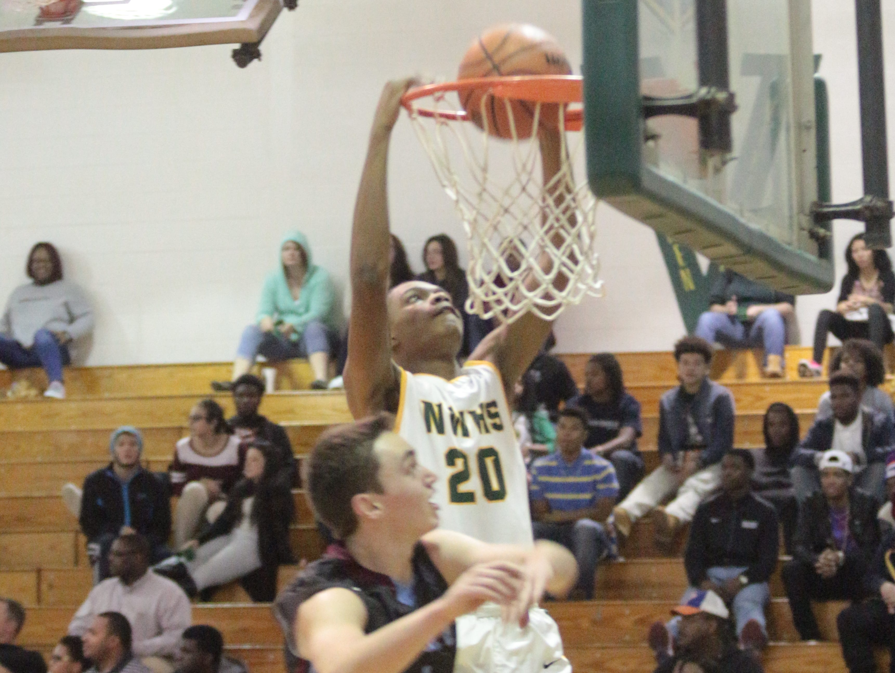 Northwest's Christian Choice (20) goes up for a dunk against University School of Nashville during the first half of their basketball game Monday night at Northwest High.