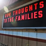 Handyman Paint & Hardware displays a sign of support in Roseburg, Ore., on Saturday, Oct. 3, 2015. Ten people, including the shooter, were killed and nine others injured in a shooting at Umpqua Community College on Thursday.