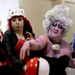 """Lexie Simpson, from left, 19, of Salem, as Harley Quinn, Savanna Vickers, 23, of Salem, as Adam Taurus, and the Sea Witch, play volleyball with a PokŽ Ball during the 3rd annual Cherry City Comic Con at the Oregon State Fairgrounds in Salem on Saturday, April 30, 2016. The self-proclaimed """"Nerd Fest"""" continues Sunday from 10 a.m. - 5 p.m."""