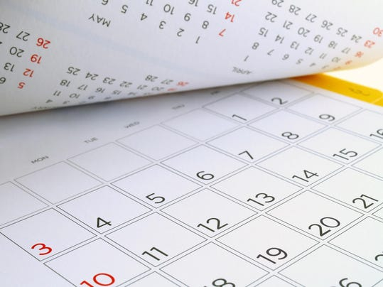 desk calendar with days and dates in July 2016