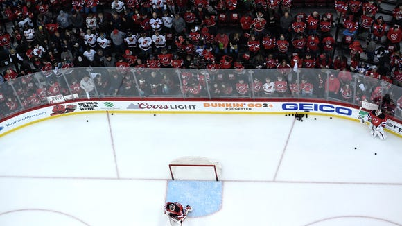 New Jersey Devils goaltender Cory Schneider (35) warms up as New Jersey Devils goaltender Keith Kinkaid (1) looks on before the Devils face the Tampa Bay Lightning in Game 3 of Round 1 of the Stanley Cup Playoffs at the Prudential Center in Newark, NJ on Monday, April 16, 2018.