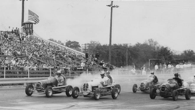 Stan Smola, (left) and Fred Moore were in the front row of the eight-man heat race at the Indianapolis Midget Speedway (16th St. Speedway) on May 19, 1947.