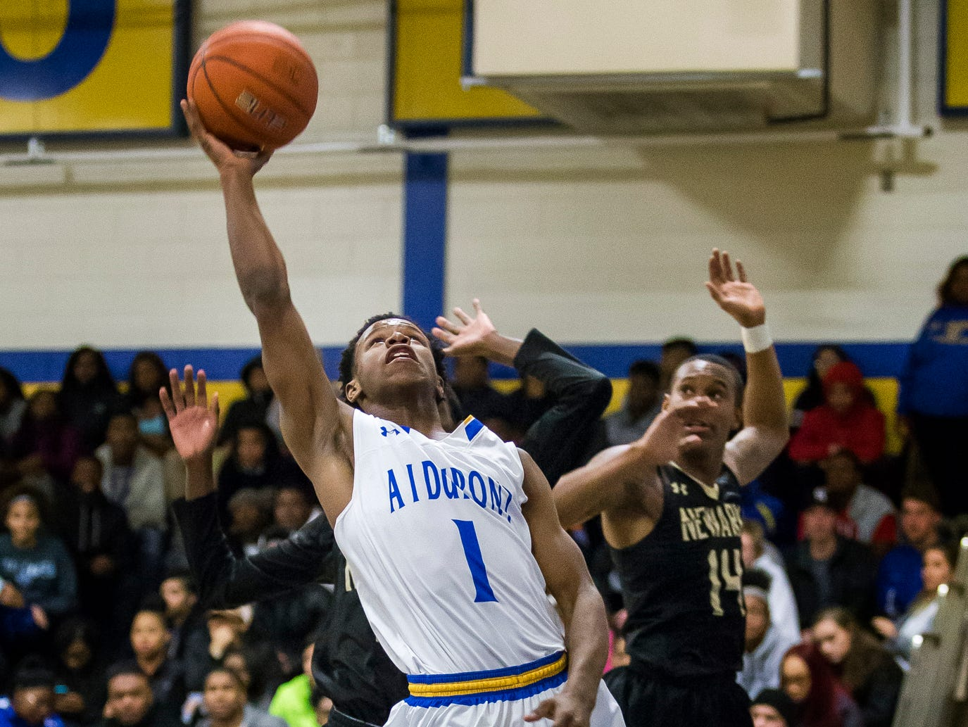 A.I.'s Julius Inge puts up a shot in the fourth quarter of Newark's 52-51 win over A.I. duPont High School in Greenville on Tuesday evening.