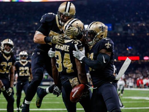 New Orleans Saints Justin Hardee celebrates with linebacker