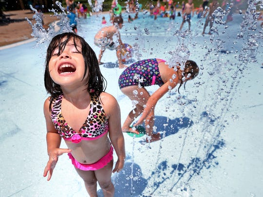 Valeria Acosta, 3, of Des Moines' east side, reacts to being sprayed with water while at Union Park Wading Pool in Des Moines on Wednesday, June 25, 2014. The wading pool is open Monday through Friday from 10 a.m. to 7 p.m. and on Saturday and Sunday from 10 a.m. to 4 p.m.
