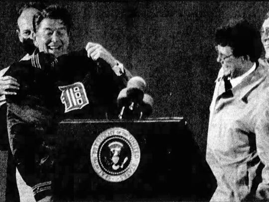 President Ronald Reagan holds up Tigers shortstop Alan