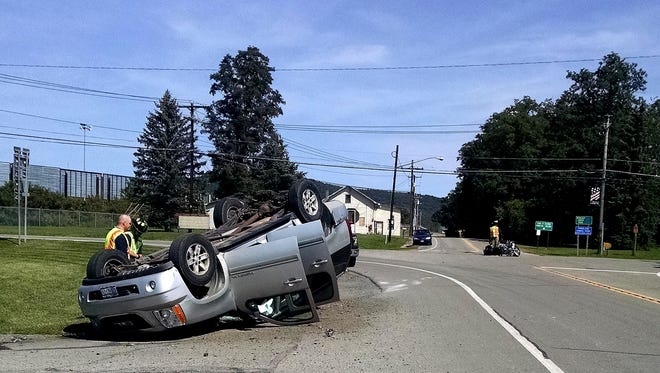An SUV flipped over after colliding with a motorcycle Monday in the Town of Chemung.