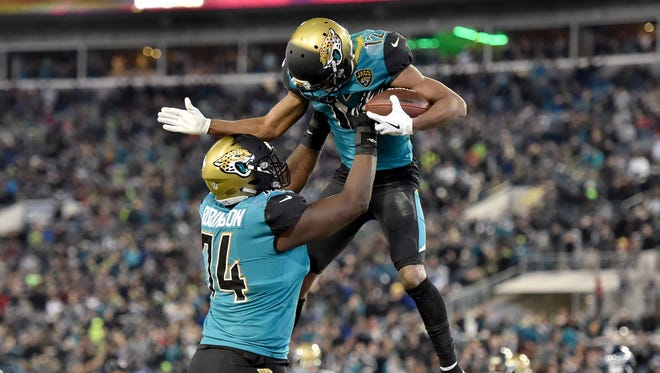 Jaguars wide receiver Dede Westbrook (right) celebrates with  offensive tackle Cam Robinson (left) after scoring a touchdown against the Seattle Seahawks during the second half at EverBank Field.