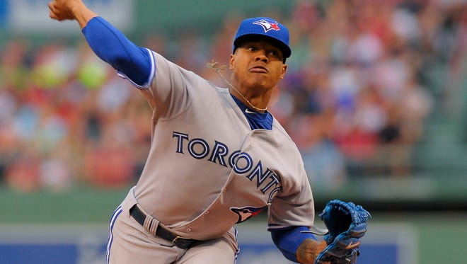 Toronto Blue Jays starting pitcher Marcus Stroman (54) pitches during the first inning against the Boston Red Sox at Fenway Park.