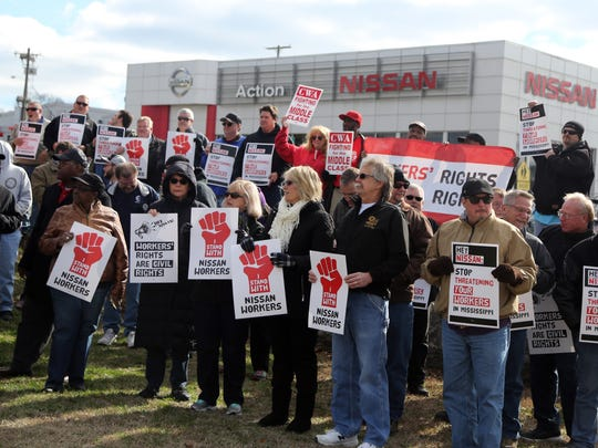 People gather in Coleman Park across from Action Nissan to protest what they feel are unfair working conditions and the inability to unionize at the Canton, Miss., Nissan plant on Thursday, Jan. 26, 2017.