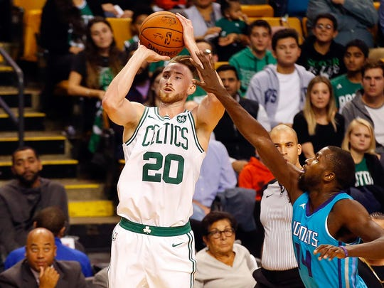 Boston Celtics forward Gordon Hayward (20) shoots against the Charlotte Hornets during the first half of a preseason game at TD Garden.