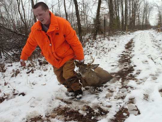 Anthony Brandenburg of Wisconsin Rapids drags out his buck near Dexterville on the opening day of the gun-deer hunting season opener in 2005.    Anthony Brandenburg of Wisconsin Rapids drags out his buck near Dexterville on the opening day of the gun-deer hunting opener Saturday.