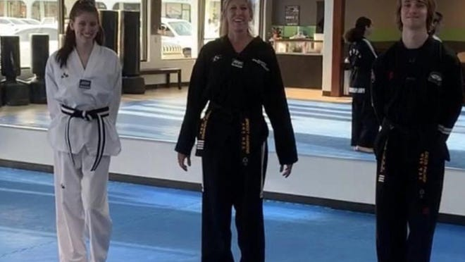 The three instructors at  PIMA Palm Beach Martial Arts studio are shown, from left to right: Grace Hammond, Bridget Hammond and Caleb Palhof.