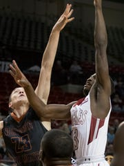 New Mexico State guard Sidy N'Dir gets a shot off over