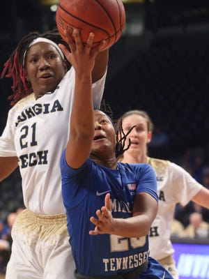 MTSU's Ty Petty (20) goes up for a shot as Georgia Tech's Zaire O'Neil (21) guards her in the third round of the WNIT Tournament on Thursday, March 23, 2017, in Atlanta.