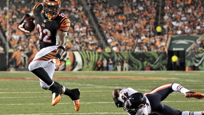 Jeremy Hill breaks a tackle and leaps into the end zone for a touchdown in the second quarter of the Bengals' 21-10 victory over the Chicago Bears on Saturday.