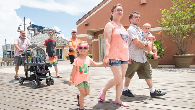 The Fortier and Apley families, of Cleveland, Ohio, walk along the Pensacola Beach boardwalk on May 23.
