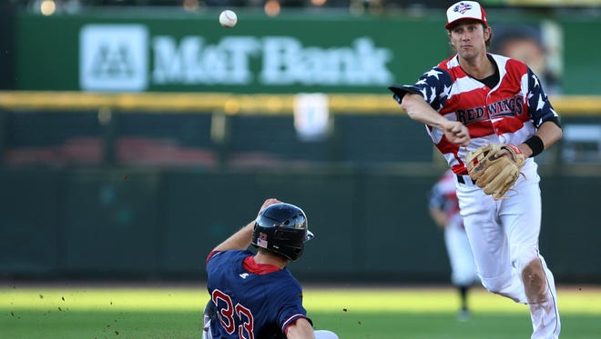 Trevor Plouffe, wearing the Red Wings special Fourth of July jersey in 2011, retires Pawtucket's Daniel Nava at 2nd base and fires to first.