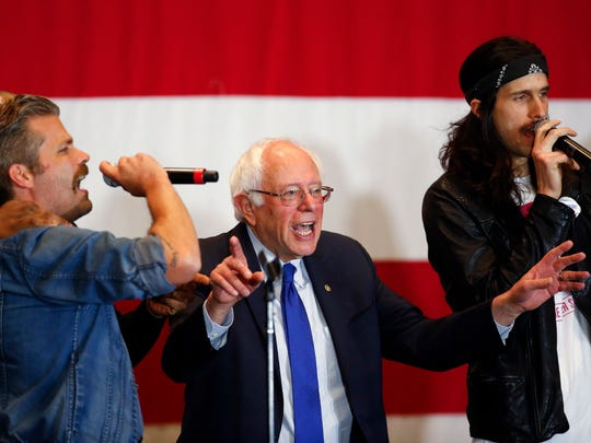 Democratic presidential candidate Sen. Bernie Sanders, I-Vt., sings during a campaign event, Monday, April 4, 2016, in Milwaukee.