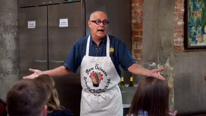 Michael DeVidts speaks to visitors at the New Orleans School of Cooking on Oct. 22, 2014.