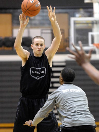 Max Hooper(10) passes while being guarded by assistant