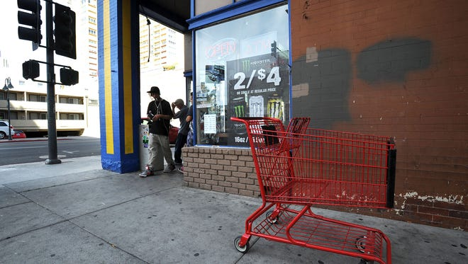 A grocery cart from Save Mart Supermarket is seen outside of Ace Mart in downtown Reno on Oct. 8, 2015.