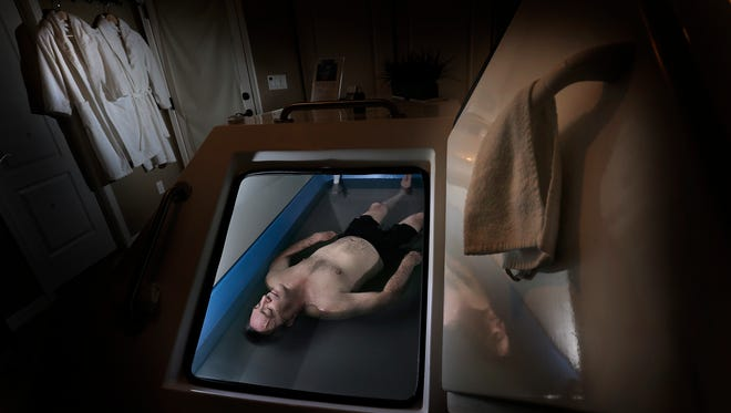 Hector Torres, 65, relaxes in a flotation therapy pod at Desert Float Center. The pod is filled with water and 1,000 pounds of Epsom salt, giving the client a weightless experience. The water is warmed to skin temperature and the pod, when closed, is dark and quiet.