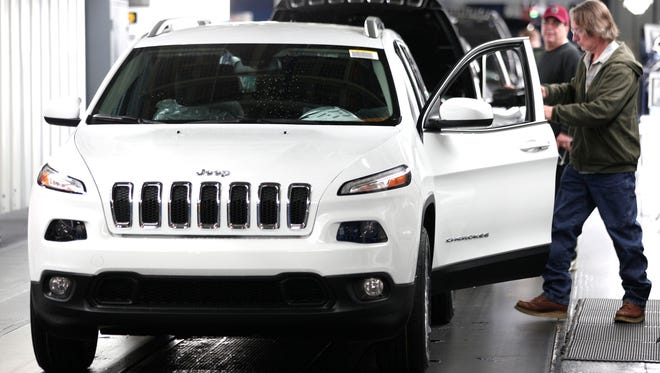 A Jeep Cherokee undergoes assembly at the Toledo North Assembly Plant in this 2014 file photo