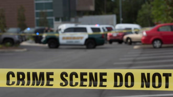 The Escambia County Sheriff Office is investigating the death of triple-murder suspect Kenneth Lever on the campus of Navy Federal Credit Union on Nine Mile Road Wednesday July 12, 2017. Lever took his own life in the financial institution's parking lot after a brief encounter with an off-duty deputy.