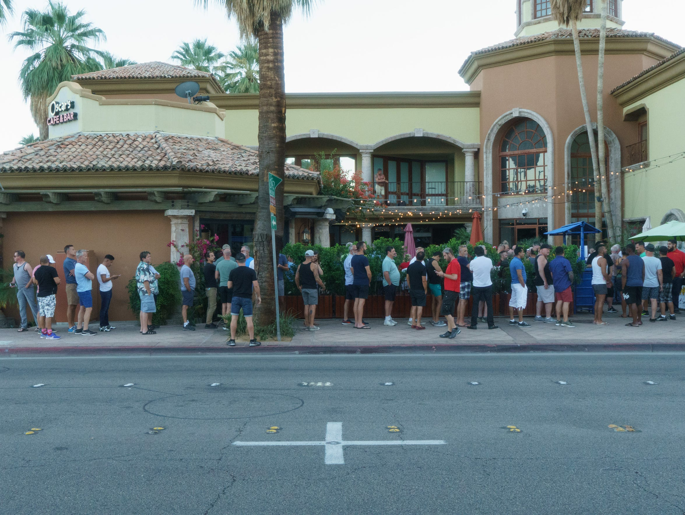 A line forms outside of Oscar's Cafe and Bar on Sunday