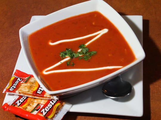 A bowl of tomato and red pepper bisque is shown at Cafe Zuppa, 320 N. Meridian St. The restaurant, known for a variety of hearty soups, has closed.