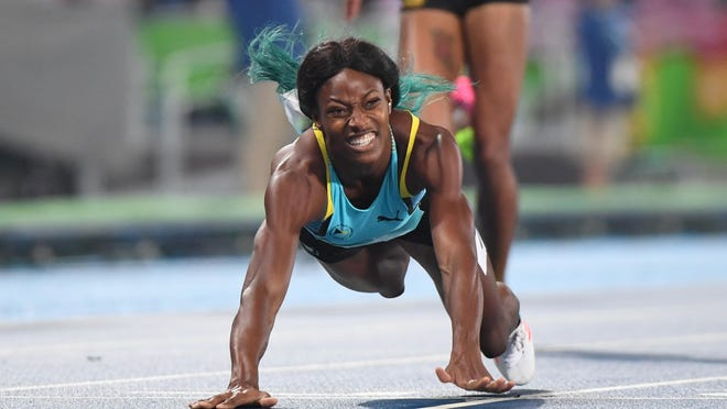 Shaunae Miller dives across the finish line to win the Women's 400-meter final on Monday.