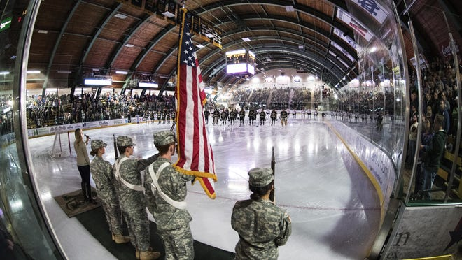 The singing of the national anthem during the men's hockey game between the Clarkson Golden Knights and the Vermont Catamouts at Gutterson Fieldhouse on Saturday night.